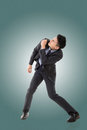 Struggle pose of asian business man full length Royalty Free Stock Photo