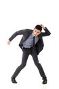 Struggle pose of asian business man full length isolated Stock Photography