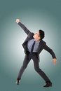 Struggle pose of asian business man full length isolated Royalty Free Stock Photography