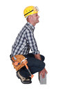 Struggling to lift a block tradesman Stock Photos