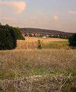 Stubble field sunny evening distance village dueppenweiler saarland germany summer Stock Photography
