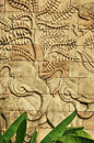 Stucco carved wall depicting elephants Stock Image