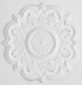 Stucco moulding rosette floral on white ceiling Stock Photo
