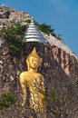 The stucco of standing buddha at the khao ngu cave in thailand ratchaburi Stock Photo