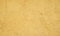 Stucco wall the empty yellow texture background Royalty Free Stock Image