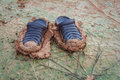 Stuck on mud dirty shoes Royalty Free Stock Photo