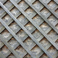 Stud wall with wooden slats on the diagonal planks for background a Royalty Free Stock Photo