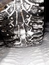 Studded winter tires on snow Stock Photography