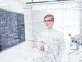 Student analyzing data and formulas general view of a in a chemistry lab with lab tools graphics on a transparent board Royalty Free Stock Photos