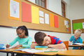 Student asleep on a desk at the elementary school Royalty Free Stock Photography