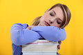 Student asleep on her books Royalty Free Stock Photo
