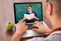 Student attending online math's lecture on laptop Royalty Free Stock Photo