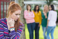 Student being bullied by a group of students female other Stock Images
