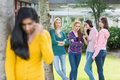 Student being bullied by a group of students female other Royalty Free Stock Image