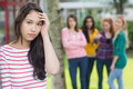 Student being bullied by a group of students portrait female other Stock Photography