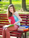 Student with book outdoor on bench Royalty Free Stock Photography