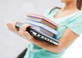 Student with books computer and folders business office school education concept Stock Photos