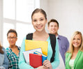 Student with books and schoolbag Royalty Free Stock Photo