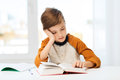 Student boy reading book or textbook at home Royalty Free Stock Photo