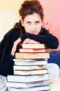 Student and bunch of books at home female Royalty Free Stock Photo
