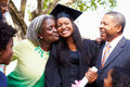 Student Celebrates Graduation With Parents Royalty Free Stock Photo