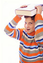 Student child with a book on his head Royalty Free Stock Photo