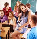 Student in classroom near blackboard. Stock Photos