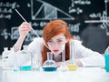 Student conducting a lab experiment general view of girl laboratory on table with colorful liquids and tools with Stock Image