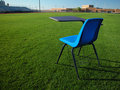 Student Desk on Football Field at School Stock Photo