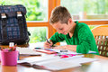 Student doing homework assignment for school at home Royalty Free Stock Image