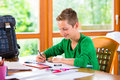 Student doing homework assignment for school at home Royalty Free Stock Photography