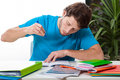 Student doing homework a handsome concentrated on his for college Royalty Free Stock Photos