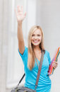 Student with folders picture of smiling waving her hand Royalty Free Stock Photos