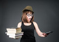 Student in funny glasses with old books in one hand and e reader in another on grey background nerd girl is comparing stack Royalty Free Stock Image