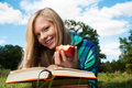 image photo : Student girl with apple and books