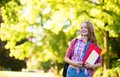 Student girl going back to school and smiling outdoors Royalty Free Stock Image
