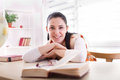 Student girl studying from books