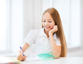 Student girl studying at school education and concept little Stock Photography