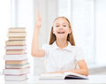 Student girl studying at school education and concept little with books raising hand up Royalty Free Stock Photos