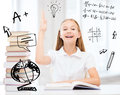 Student girl studying at school education and concept little with books raising hand up Royalty Free Stock Images