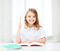 Student girl studying at school education and concept little and raising hand Royalty Free Stock Photo
