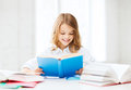 Student girl studying at school education and concept little and reading book Royalty Free Stock Image