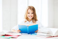 Student girl studying at school education and concept little and reading book Stock Photo
