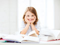 Student girl studying at school education and concept little and reading book Royalty Free Stock Images
