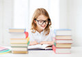 Student girl studying at school education and concept little and reading books Royalty Free Stock Image