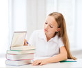 Student girl studying at school education and concept little and reading books Royalty Free Stock Photo