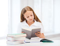 Student girl studying at school education and concept little and reading books Royalty Free Stock Images