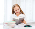 Student girl studying at school education and concept little and reading books Stock Photography