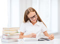 Student girl studying at school education and concept little and reading books Stock Images