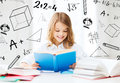Student girl studying at school education and concept little and reading books Stock Image